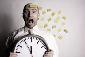 Disorganized business guy with clock and post its.