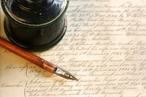 pen, inkwell and page of text
