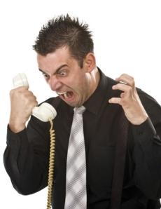 upset guy yelling into phone