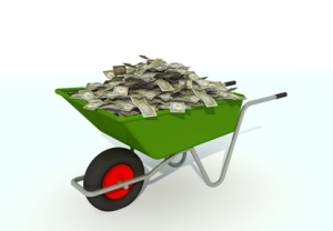 pile of money in wheel barrow