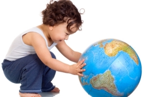 Child playing with globe