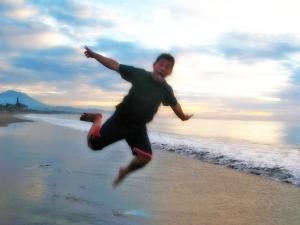 boy jumping like airplane