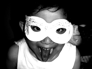 little girl wearing eye mask