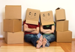 couple with brown boxes on heads