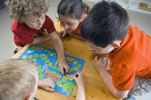 preschoolers around table playing game