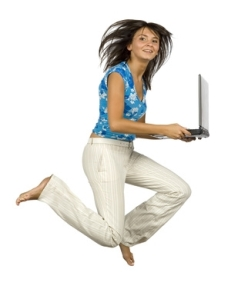 jumping happy woman with laptop