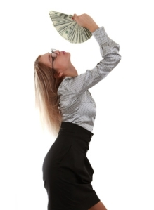 business woman with fan of 100 dollar bills