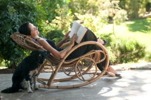 reading in rocker with dog