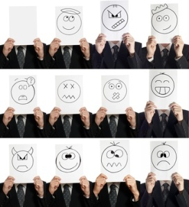 expressions drawn on white paper held up by businessman
