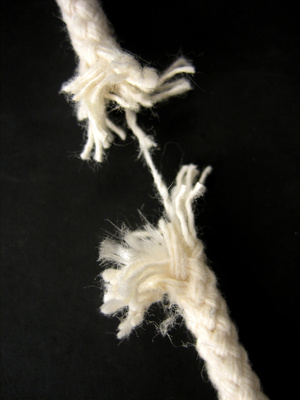 rope with one hanging thread about to snap