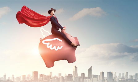 Business woman with red cape on pink pig, flying above city skyline.