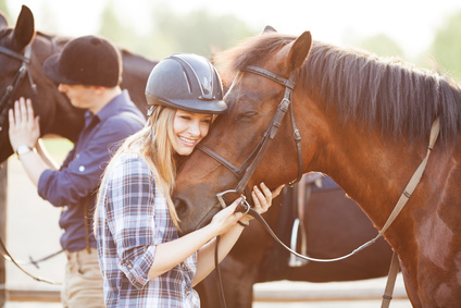young woman hugging horse with blissful look on her face and horse's face