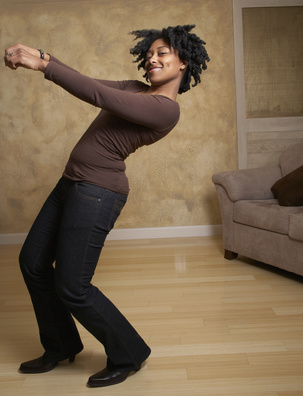 woman dancing in living room alone