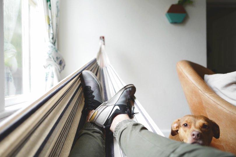 guy indoor hammock drew-coffman-125736-unsplash